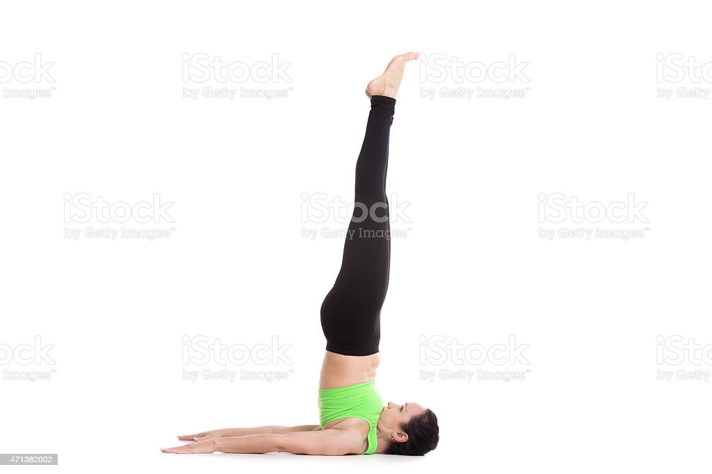 Unsupported Shoulderstand yoga asana stock photo