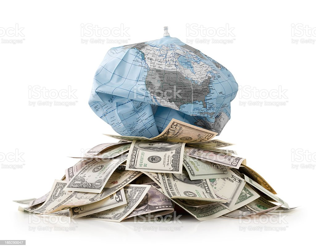 Unsustainable development. Heap of money with globe deflates. royalty-free stock photo