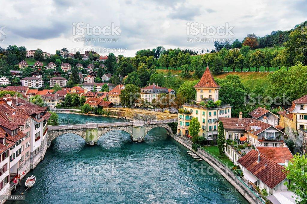 Unterbrucke bridge over Aare River and old houses in Bern, Switzerland. View from Nydeggbrucke bridge stock photo