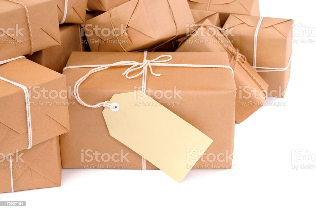 Untidy pile of brown parcels with label stock photo