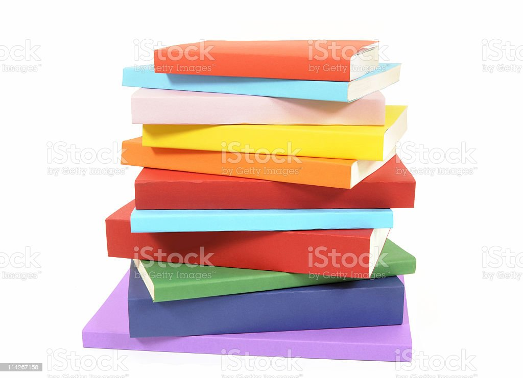 Untidy stack of colorful paperback books stock photo
