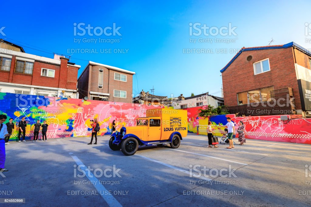 Untitled tourists visit the parking lot that displays the historic yellow car of Louis Vuitton on Jun 19, 2017 in Samcheong-Dong, Seoul city, Korea stock photo