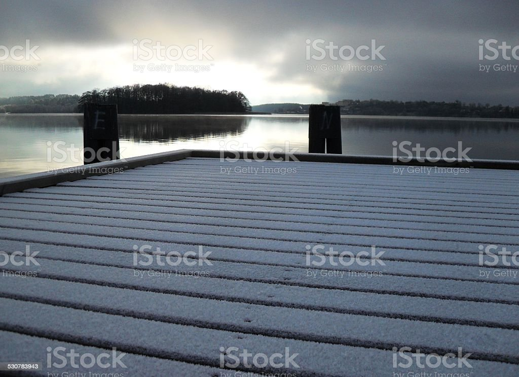 untouched snow on the pier and abandoned lake stock photo