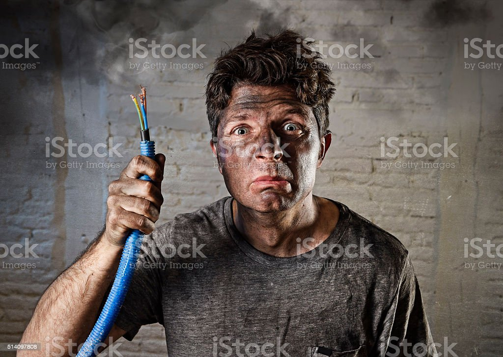 untrained electrocuted man plugging cable suffering electrical accident stock photo