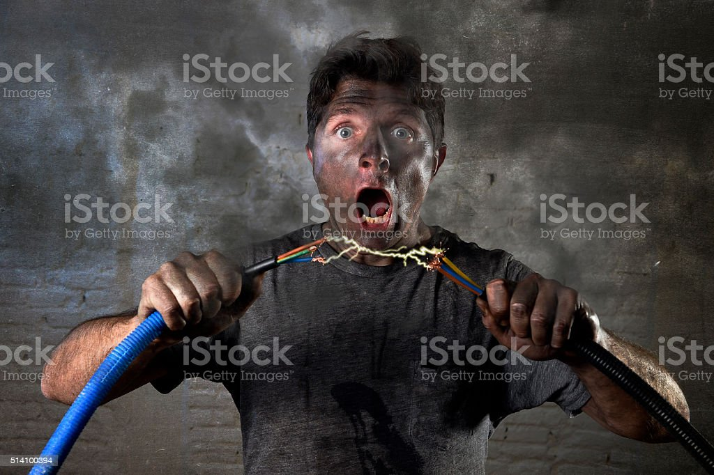 untrained man electrocuted connecting cable suffering electrical accident stock photo