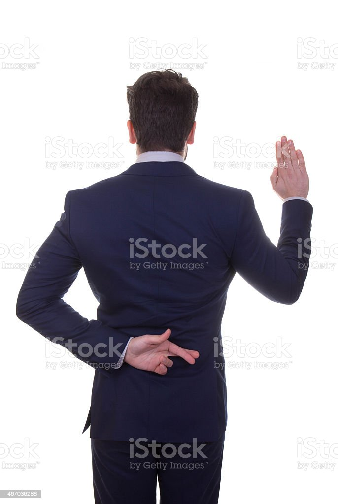 untrustworthy, lying, business man fingers crossed stock photo