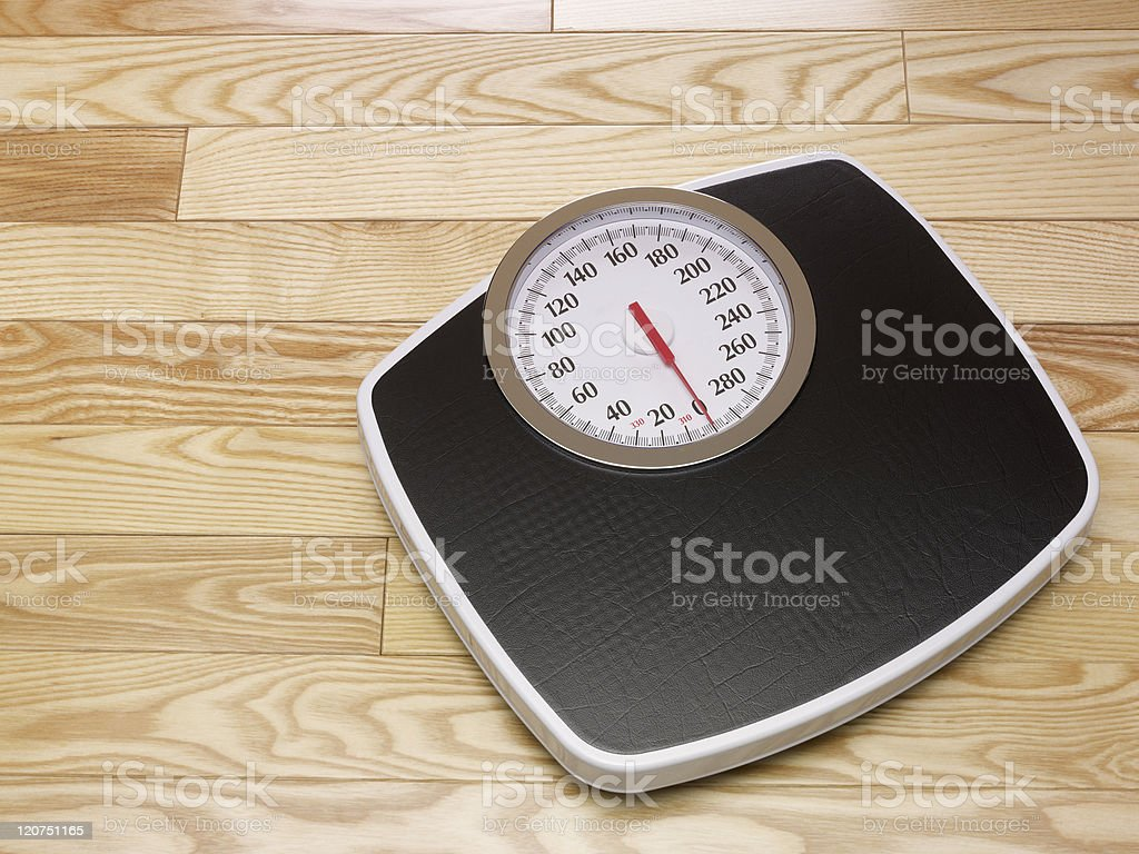 Unused black and white scale on light wooden floor stock photo