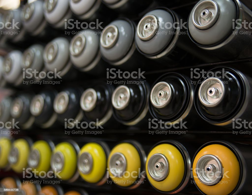 unused cans of spray paint stock photo