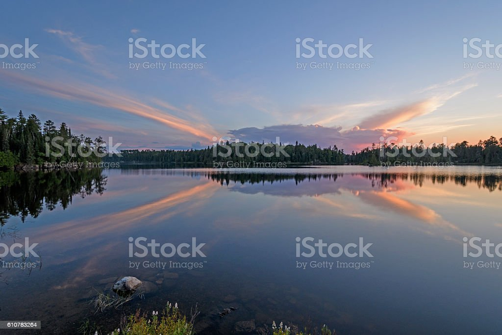 Unusual Clouds at Sunset in the North Woods stock photo