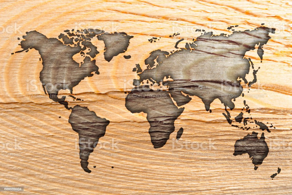 Unusual Earth map on textured wood background stock photo