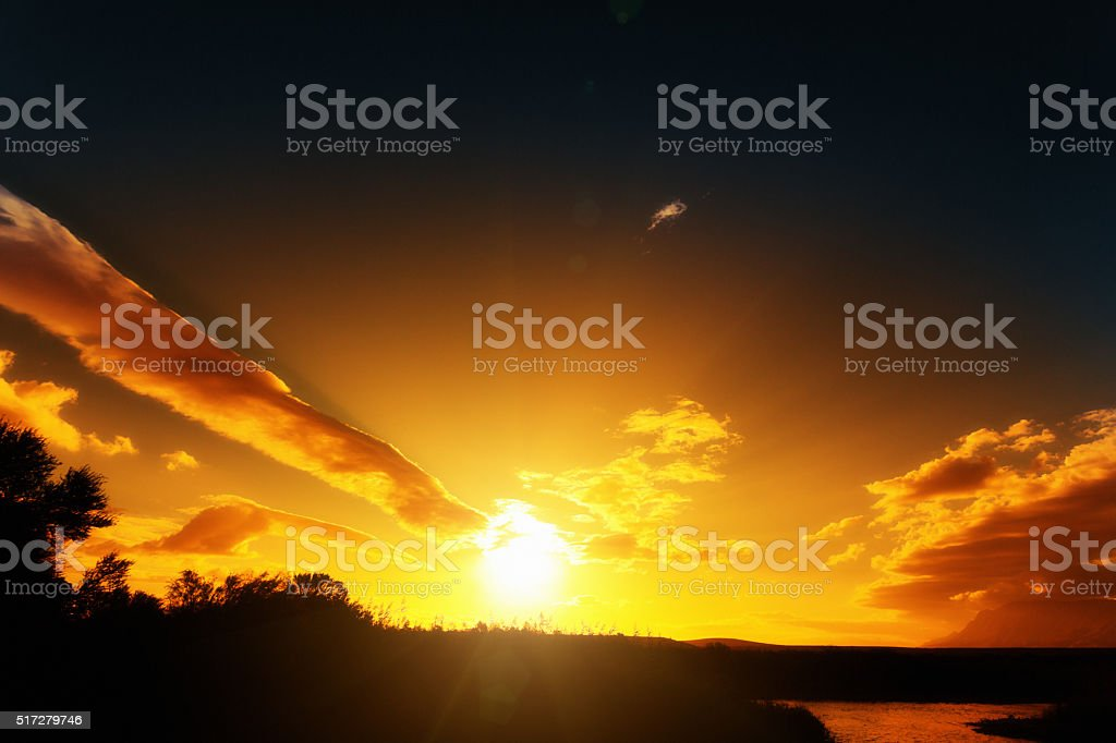 Unusual fingerlike cloud points at golden setting sun stock photo