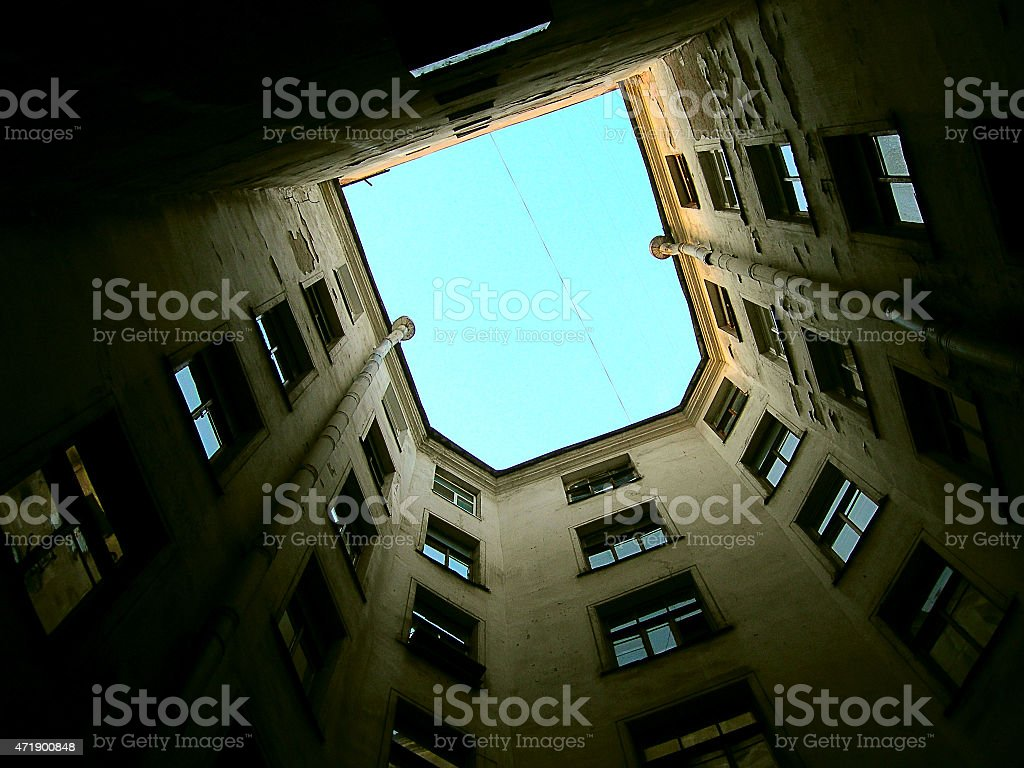 Unusual foreshortening of the walls multi-storey old house. stock photo