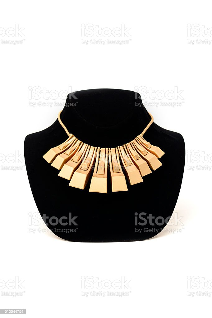 unusual gold necklace on a mannequin stock photo