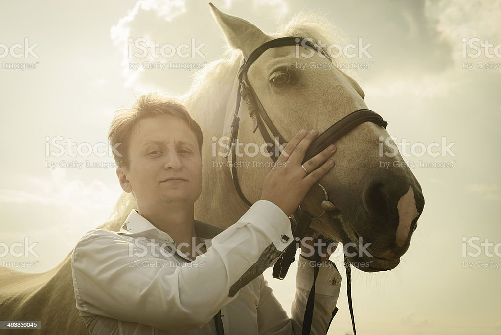 unusual groom at wedding on white horse outdoors royalty-free stock photo