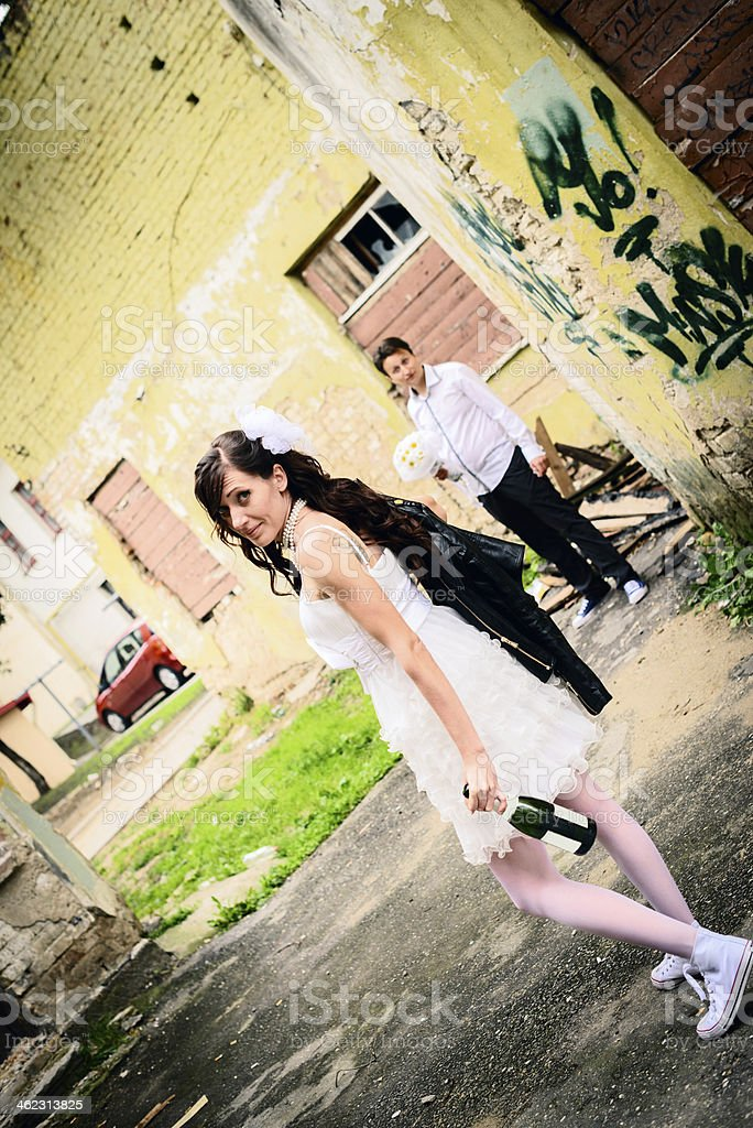 unusual loving wedding couple at thrown house royalty-free stock photo