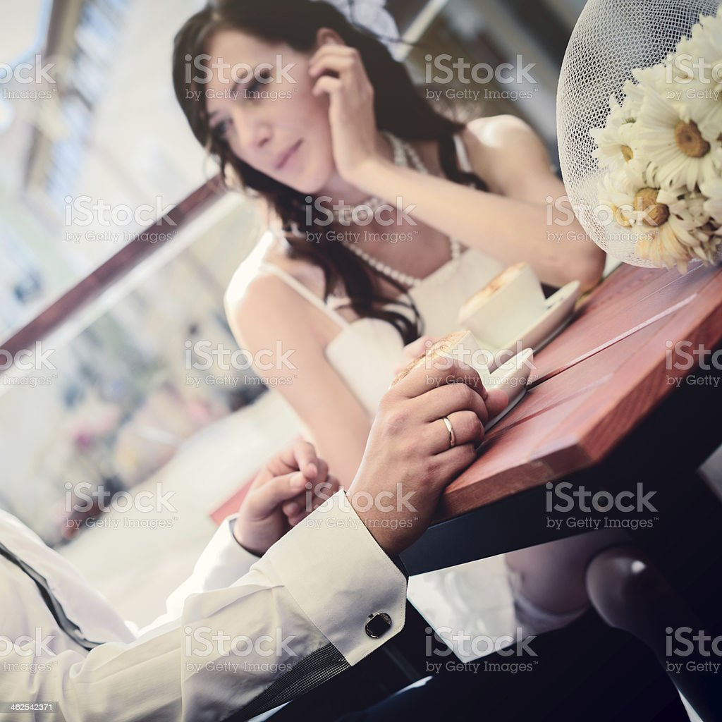 unusual loving wedding couple in cafe drinks cappuccino royalty-free stock photo