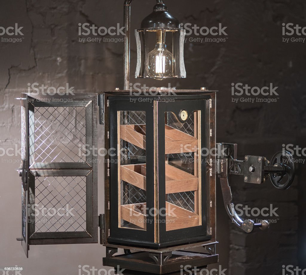 Unusual metal container for storing cigars. Humidor. stock photo
