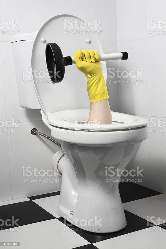 unusual plumber with plunger (joke) stock photo