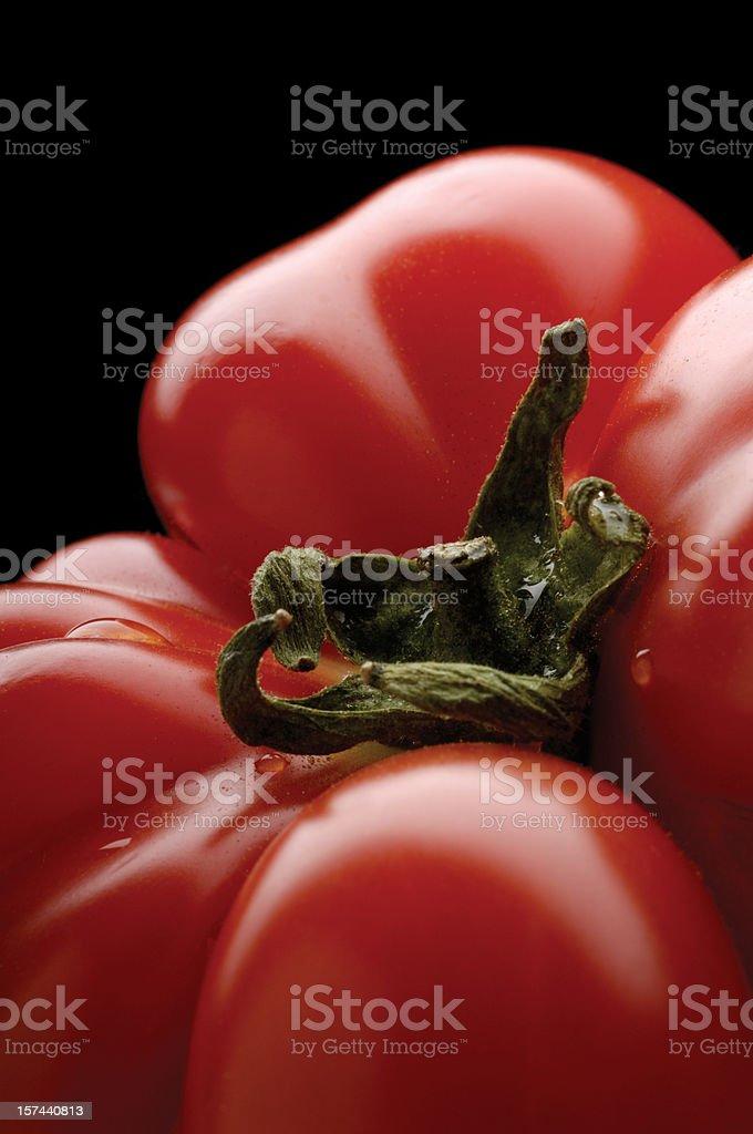 Unusual shapad tomato on black bacground. Shallow depth of field. royalty-free stock photo