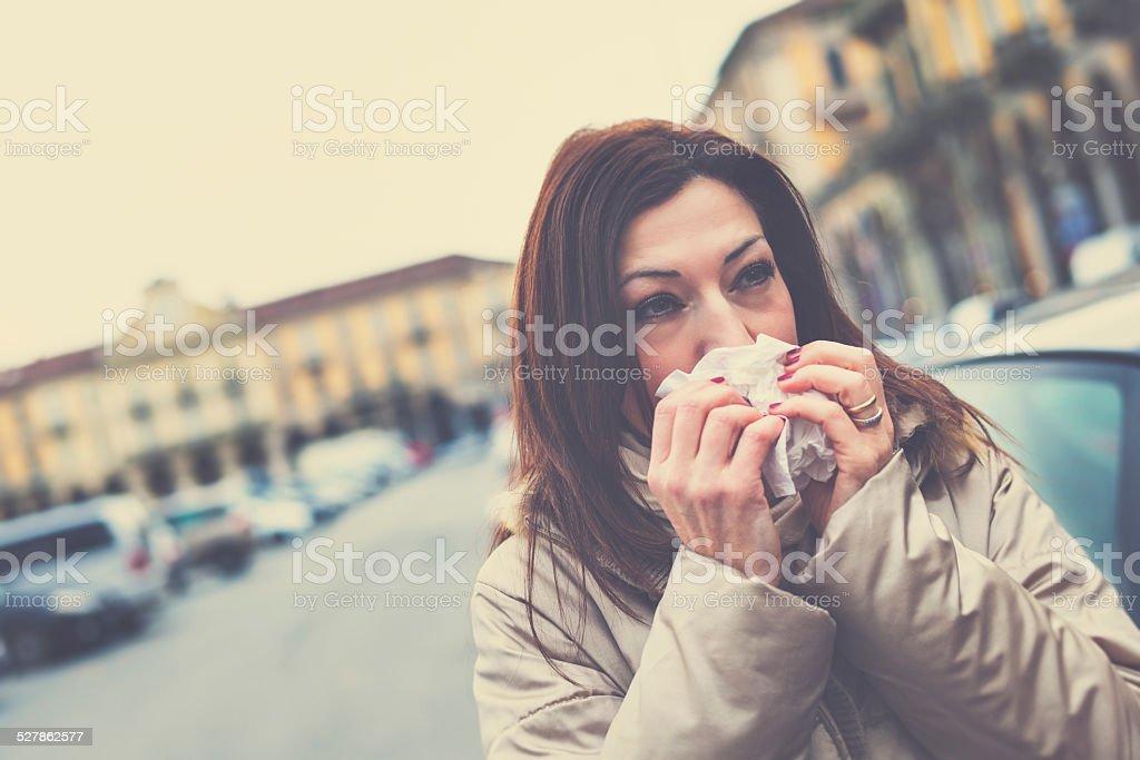 Unwell mature woman on the street stock photo