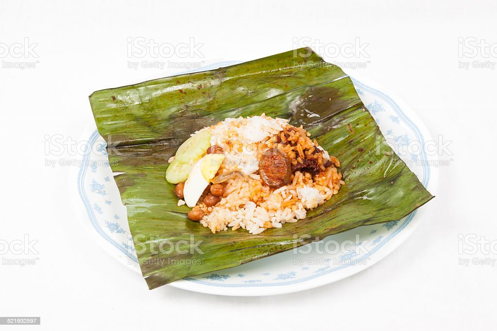 Unwrapped simple and original nasi lemak served on plate stock photo