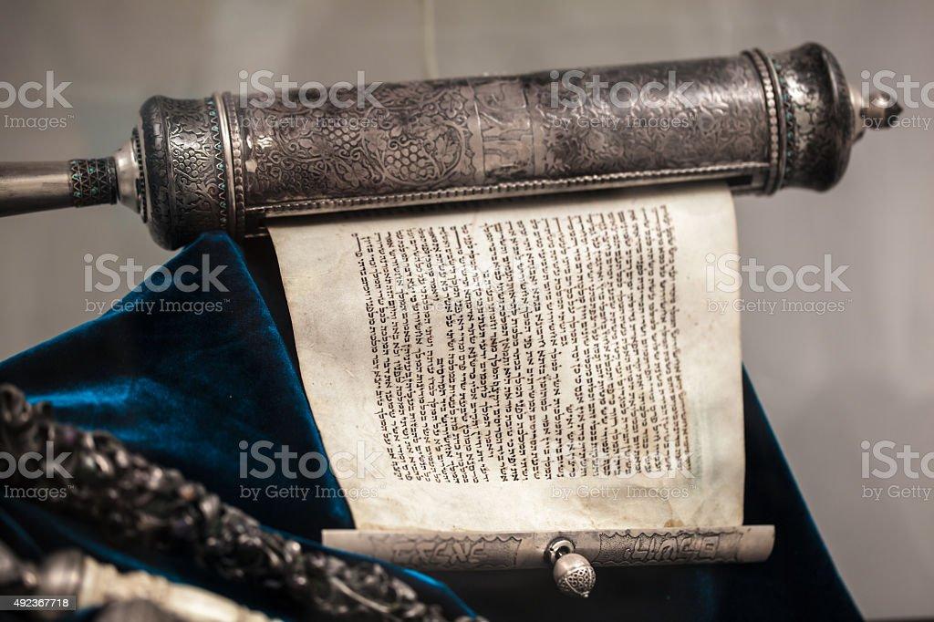 unwrapped Torah scroll silver stock photo