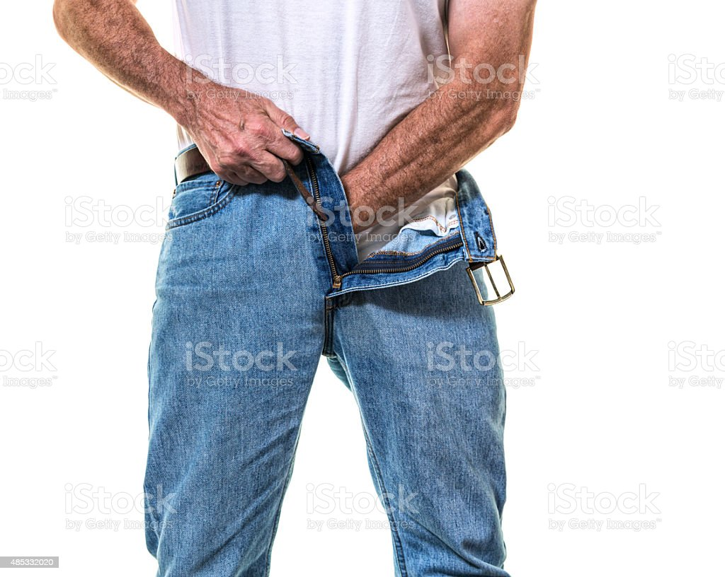 Unzipped Jeans Adult Man Adjusting White T-Shirt stock photo