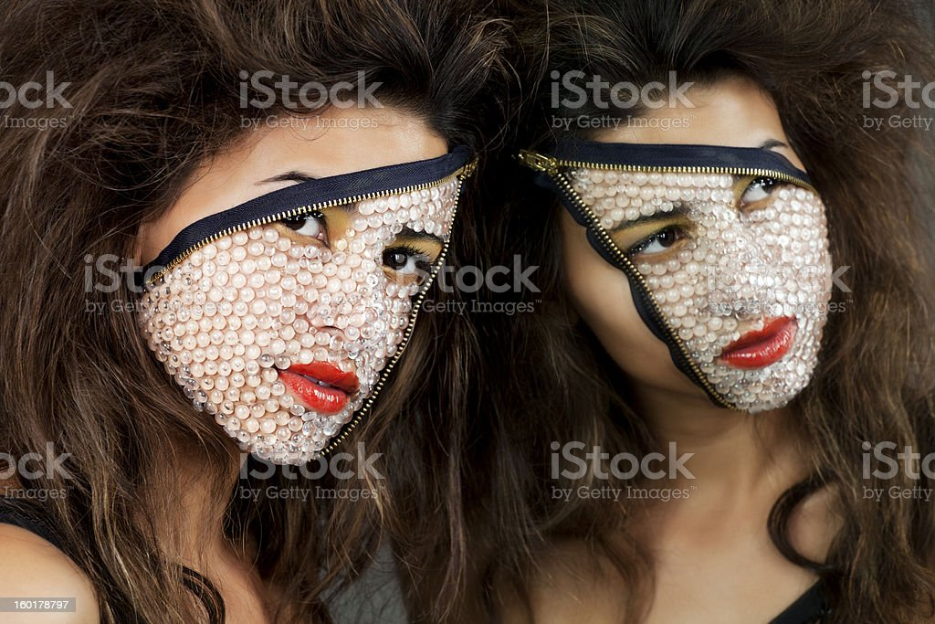 Unzipped: sexy alien two-faced woman with reflection in a mirror stock photo