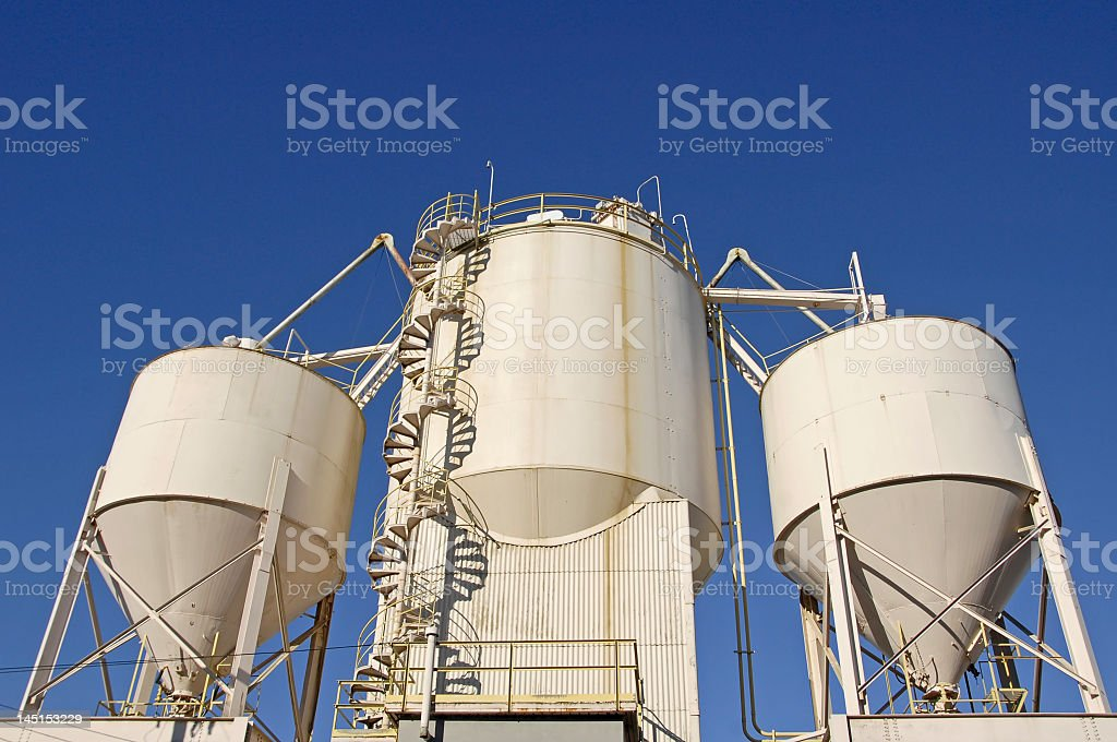 Up angle view of a cement plant with a spiral staircase royalty-free stock photo