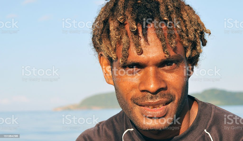 Up close facial portrait of a Pacific Islander male royalty-free stock photo