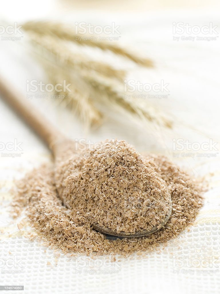 Up close photo of a heaping spoonful of oat bran stock photo