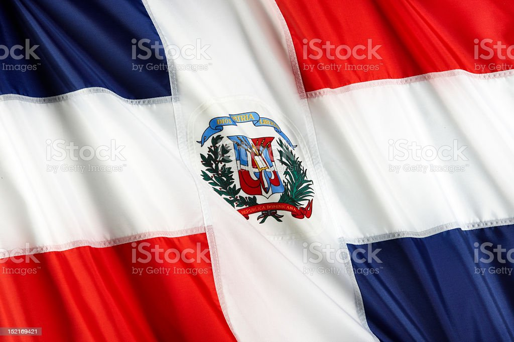 Up close photo of rippling Dominican Republic flag royalty-free stock photo