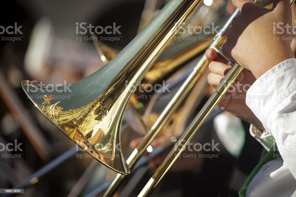 Up close picture of a musician playing a trombone stock photo