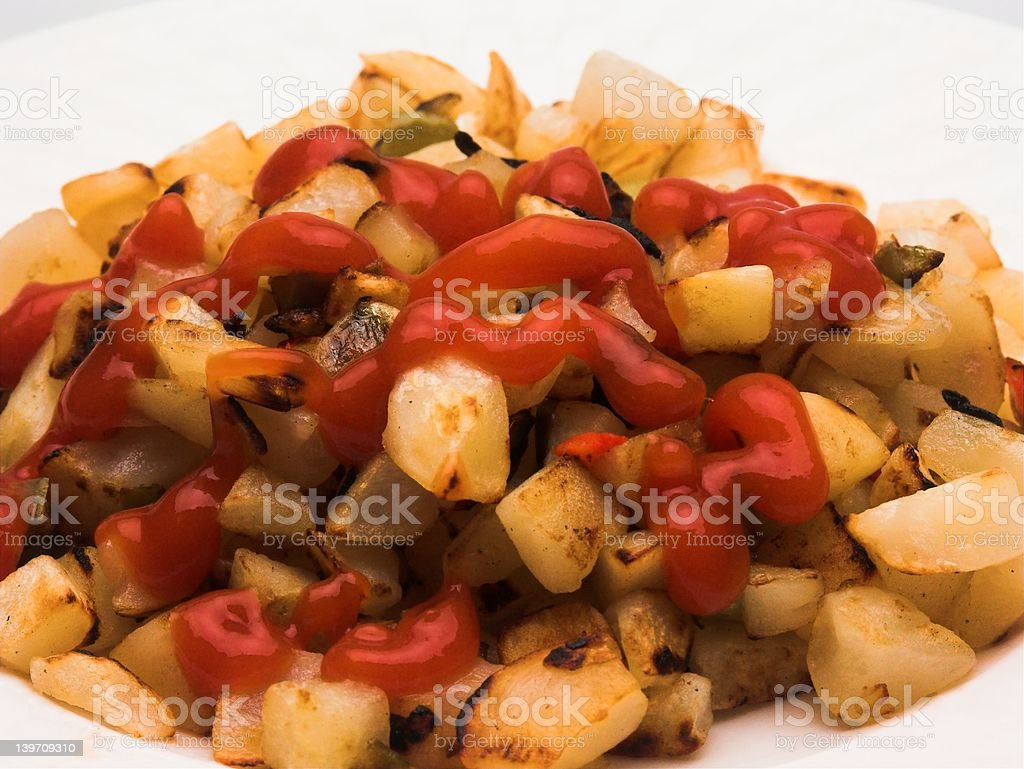 Up Close to Hash Brown Potatoes with Ketchup royalty-free stock photo