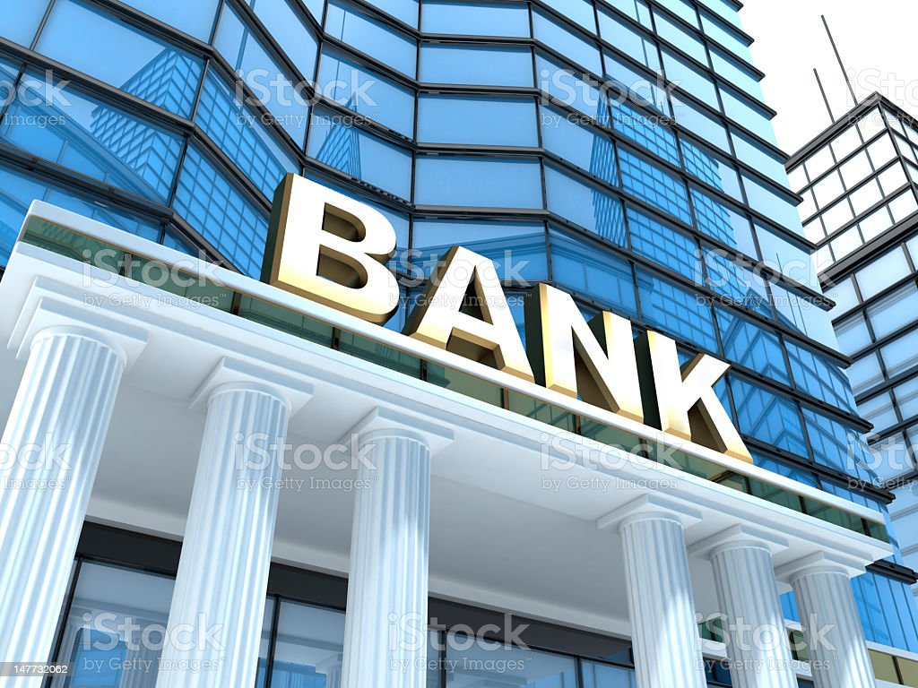 A up close view of the white pillared entrance of a bank  stock photo