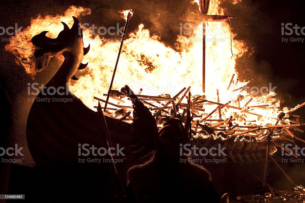 Massive Viking ship on fire in the night stock photo