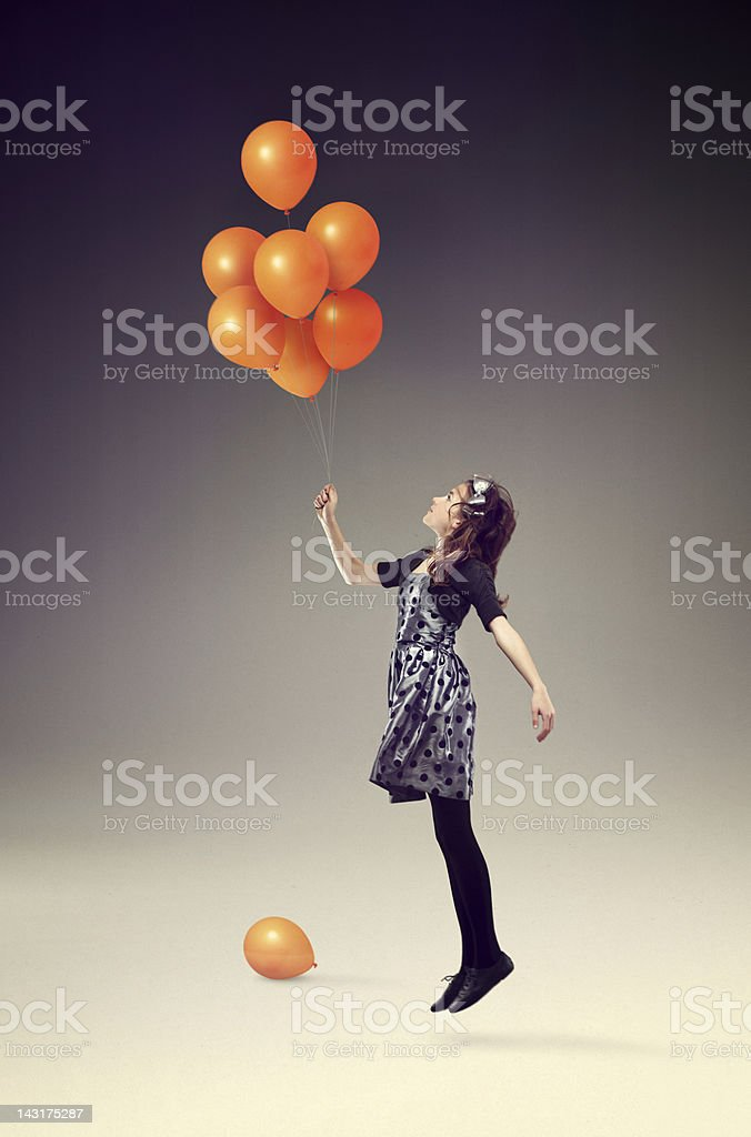 Up in the air with orange balloons stock photo