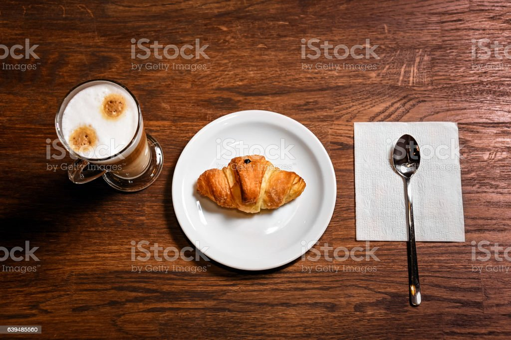 up of coffee and croissant stock photo