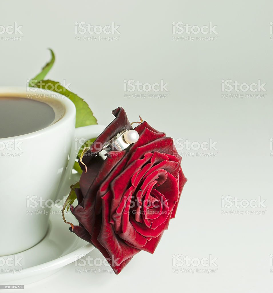 Сup of coffee with rose and ring stock photo