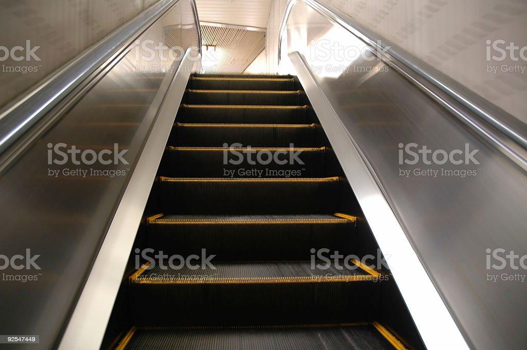Up the escalator royalty-free stock photo