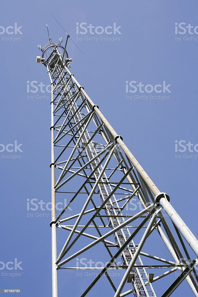 Up view of a communications tower against blue sky stock photo