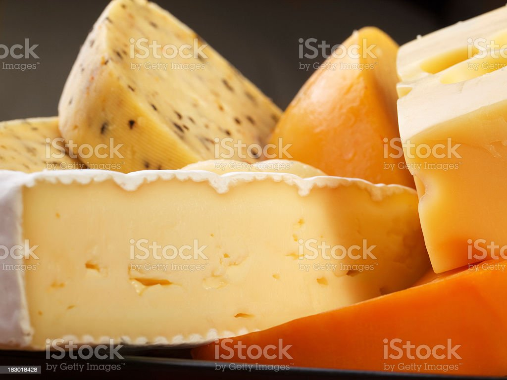 Up-close shot of Various cheeses royalty-free stock photo