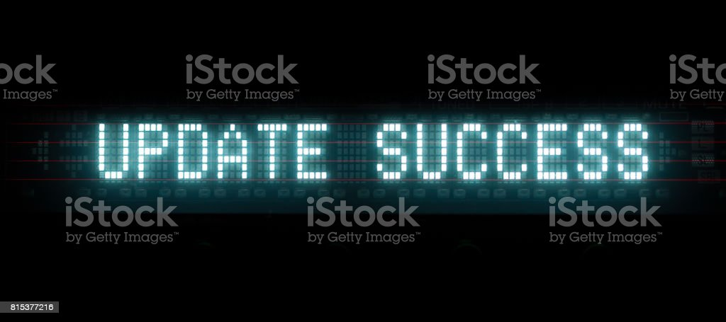 'update success' digital message, blue led text matrix stock photo