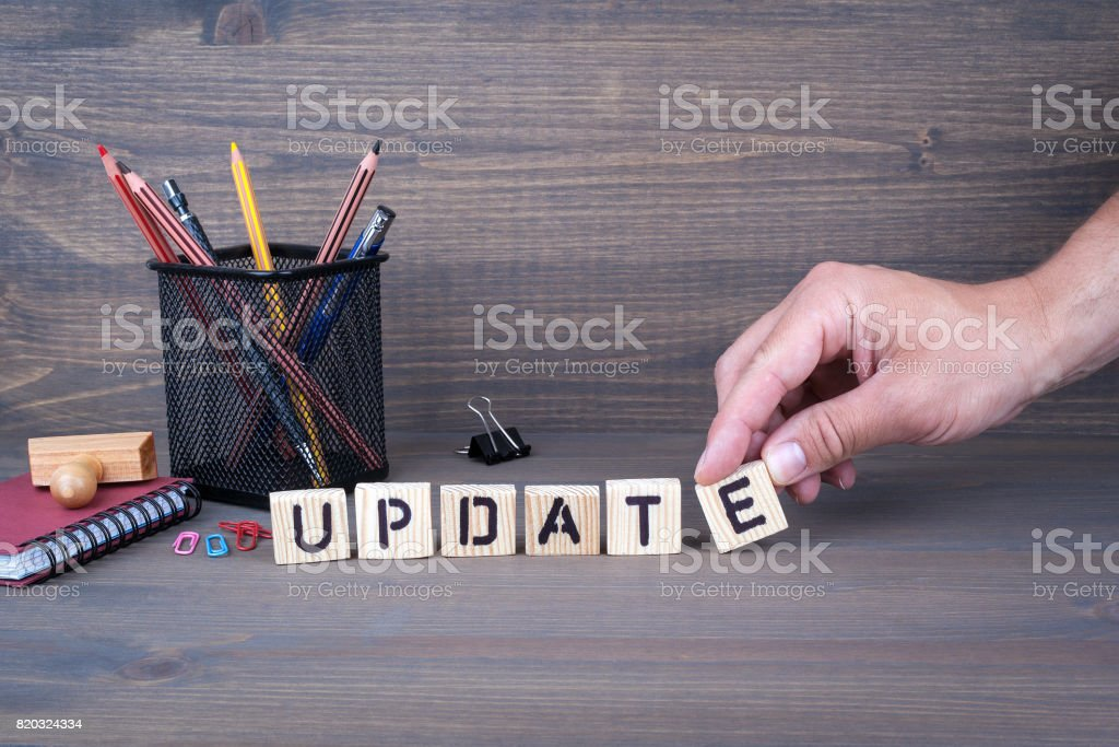 update. Wooden letters on dark background stock photo