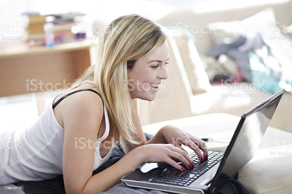 Updating her status - Social networking royalty-free stock photo