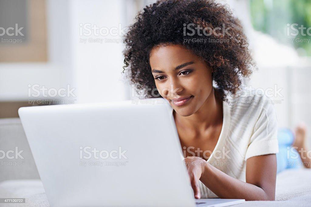 Updating her website's content stock photo