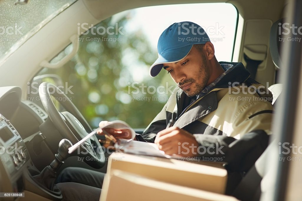 Updating his delivery status stock photo