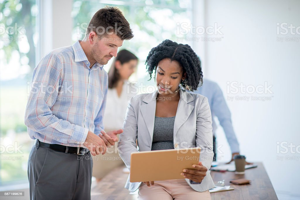 A multi-ethnic group of business professionals, entrepreneurs, and...
