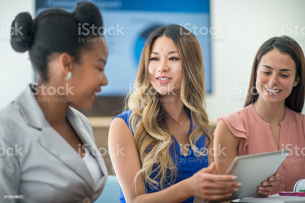 A multi-ethnic group of businesswomen and entrepreneurs are working...