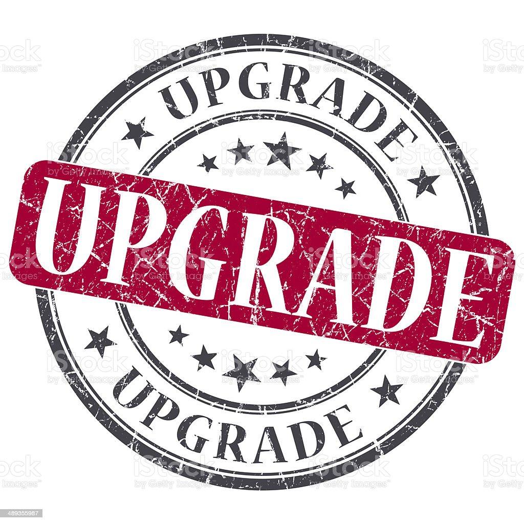 Upgrade red grunge round stamp on white background stock photo